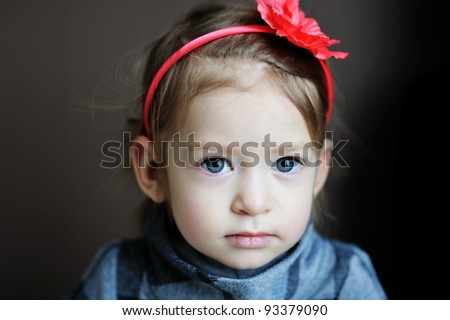 Portrait of adorable baby girl with flower headband - stock photo