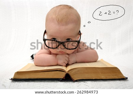 portrait of adorable baby in glasses counting in mind with handwritten thought tag with case study - stock photo