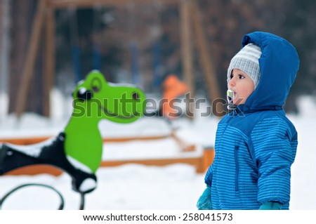 Portrait of adorable baby on playground - stock photo