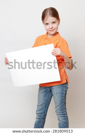 Portrait of adorable caucasian little girl with white blank for advertisment - stock photo