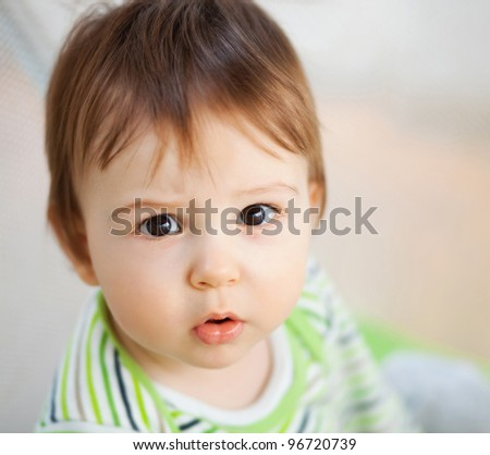 Portrait of adorable child apparently confused - stock photo