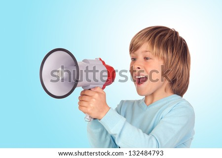 Portrait of adorable child with a megaphone isolated on a over blue background - stock photo