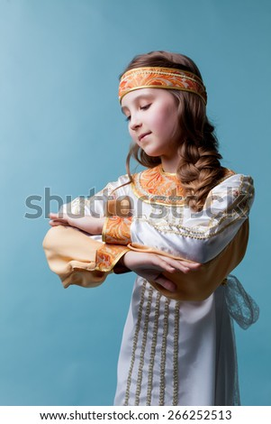 Portrait of adorable girl dancing in folk costume - stock photo