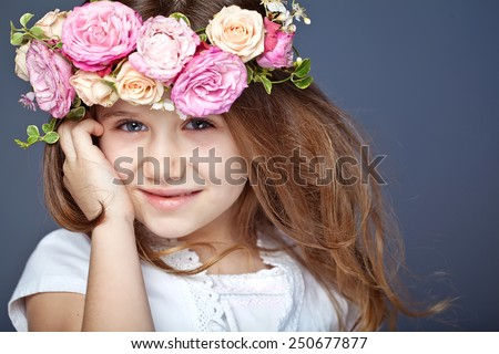 Portrait of adorable kid girl with flower wreath  - stock photo
