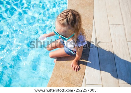 Portrait of adorable little girl have fun near swimming pool outdoors - stock photo