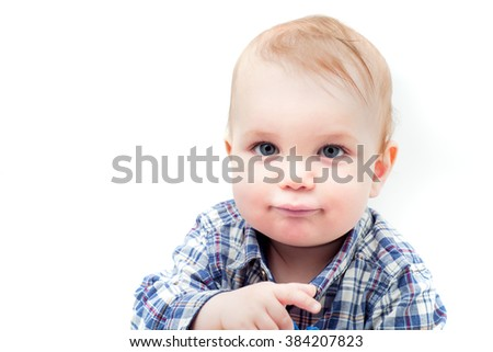 Portrait of adorable serious caucasian blond blue-eyed baby boy in plaid shirt, isolated on white background, horizontal photo - stock photo