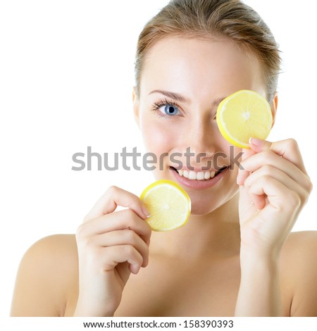 Portrait of adorable smiling girl with lemon, over white - stock photo