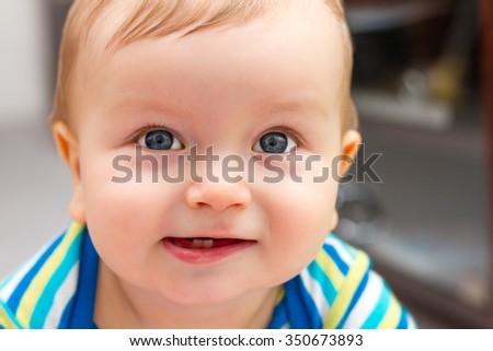Portrait Of Adorable Smiling Little Boy With Two Teeths - stock photo