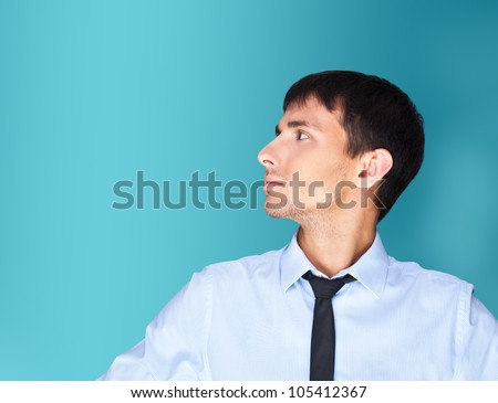 Portrait of adult business man looking at left side of shot and thinking. He is planning new global internet marketing campaign - stock photo