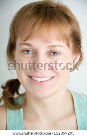 Portrait of adult woman in blue t-shirt. Closeup. - stock photo