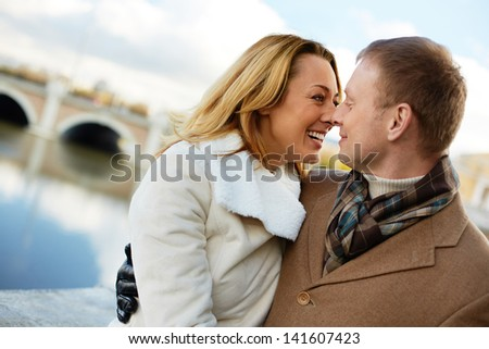 Portrait of affectionate couple having good time outside - stock photo