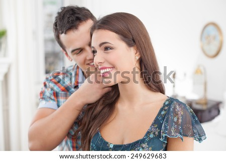 Portrait of affectionate young couple - stock photo