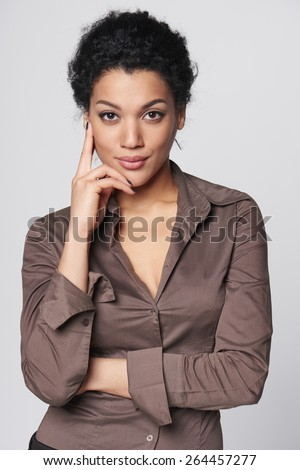 Portrait of african american business woman looking confident - stock photo