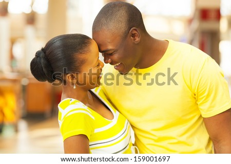 portrait of african american couple flirting - stock photo