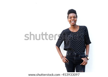 Portrait of african american woman posing against white background with copy space - stock photo