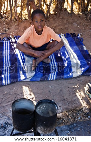 Portrait of African child in the hut, location Mmankodi village, Botswana - stock photo