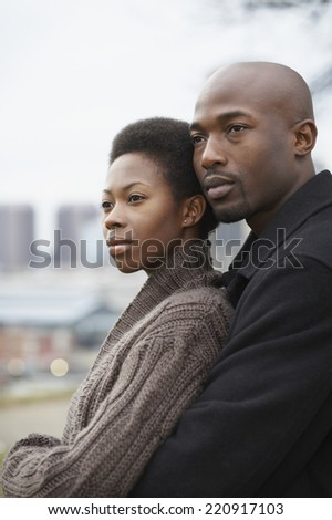 Portrait of African couple hugging - stock photo