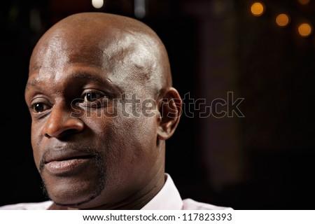 Portrait of african guy looking sideways - stock photo