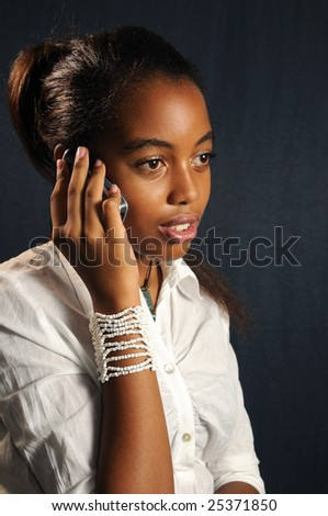 Portrait of african teen girl using cell phone - stock photo