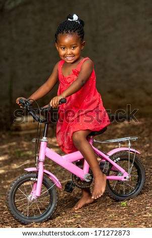 Portrait of african youngster riding cycle outdoors. - stock photo