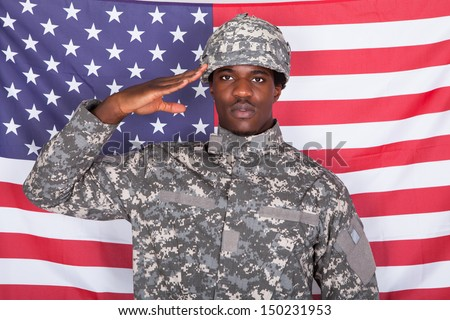 Portrait Of Afro-american Army Soldier Saluting In Front Of American Flag - stock photo