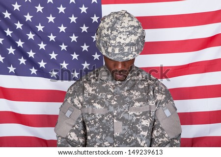 Portrait Of Afro-american Army Soldier Standing In Front Of American Flag - stock photo