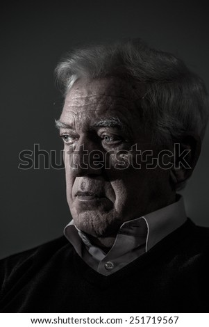 Portrait of aged man suffering from depression - stock photo