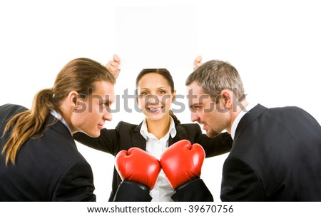 Portrait of aggressive businessmen in boxing gloves with happy female with blank paper between them - stock photo