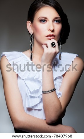 portrait of alluring brunette over dark background - stock photo