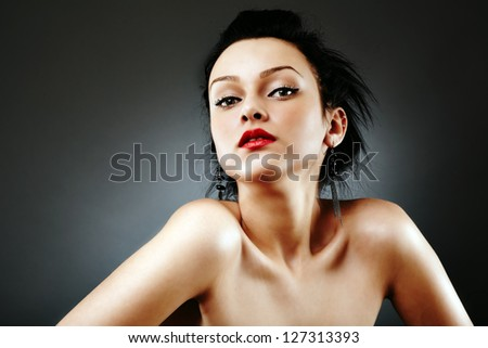 Portrait of alluring woman on gray background - stock photo