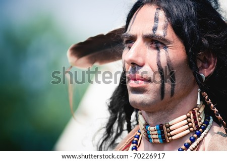 Portrait of american indian in national dress - stock photo