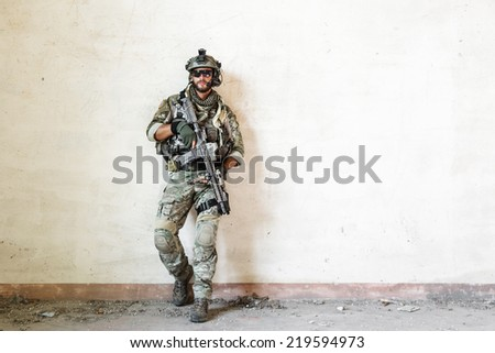 Portrait of american poses during military operation - stock photo