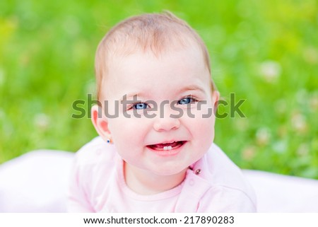 Portrait of an adorable and cheerful baby girl  - stock photo
