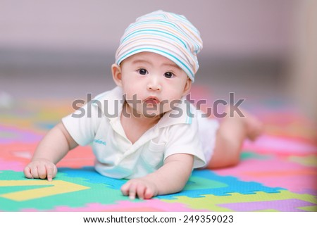 Portrait of an adorable baby boy - stock photo