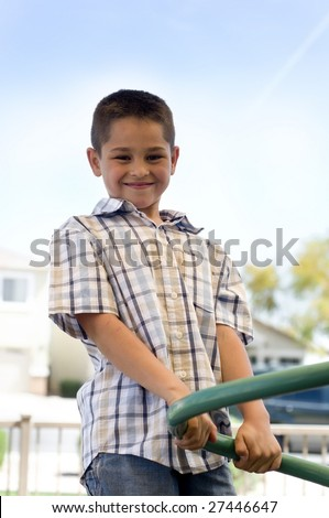 Portrait of an adorable little boy playing in park - stock photo