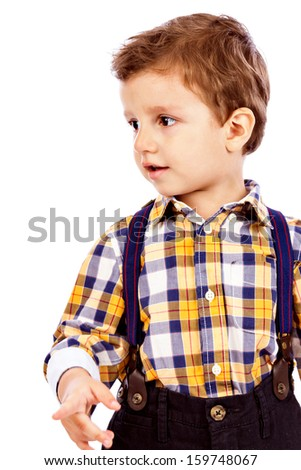 Portrait of an adorable little boy pointing something isolated on white background  - stock photo