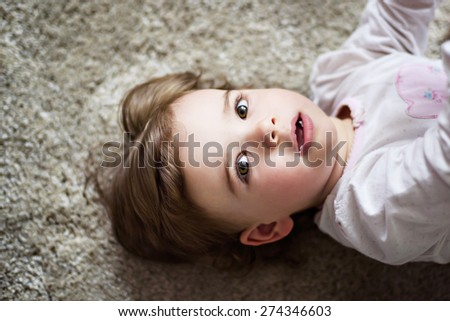 portrait of an adorable little girl in the room - stock photo