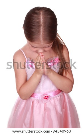 Portrait of an adorable praying girl over white background/girl is praying - stock photo