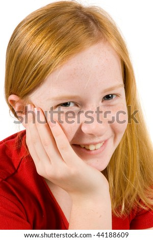 portrait of an adorable young girl with her hand on cheek on white background - stock photo