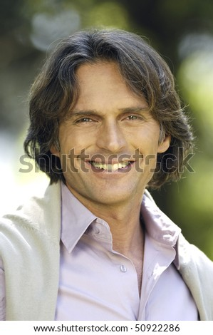 Portrait of an adult man smiling - stock photo