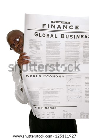 Portrait of an African American businessman reading a newspaper, isolated on white - stock photo