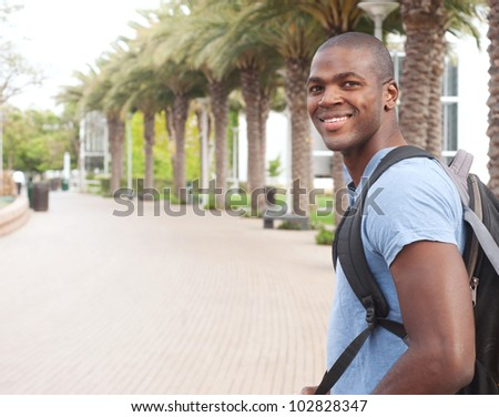 portrait of an African American college student on campus - stock photo
