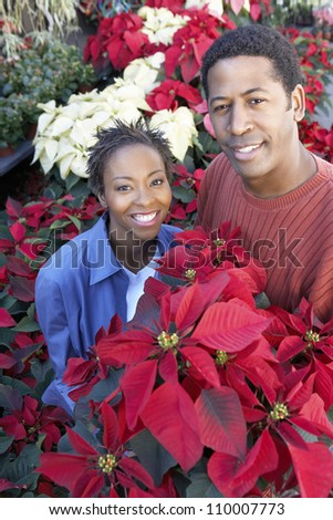 Portrait of an African American couple buying plants - stock photo