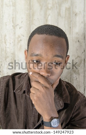 Portrait of an African American hold his chin and thinking - stock photo
