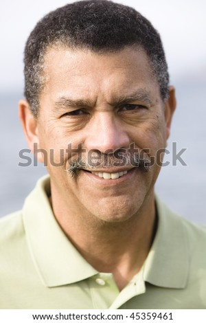 Portrait of an African American Man Outdoors - stock photo