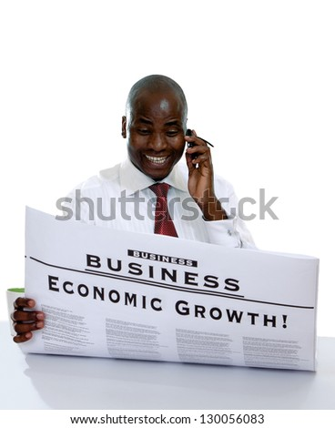 Portrait of an African American sitting with newspaper - stock photo