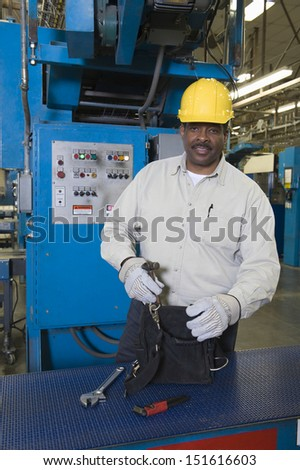 Portrait of an Afro American man working in newspaper factory - stock photo