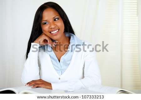 Portrait of an afro-american young black girl studying at soft colors composition - stock photo