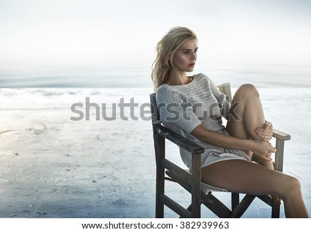 Portrait of an alluring woman sitting on the retro wooden  chair - stock photo