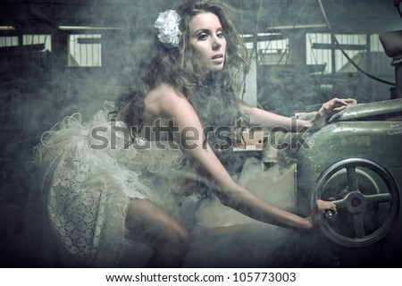 Portrait of an amazing woman cuts the boards - stock photo